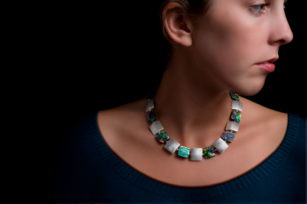 photo retouching of a jewelry model before and after image